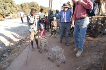 the children make their own toys from wires and bottle caps