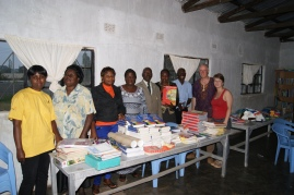 Graceland school teachers with the new delivery of books and school material