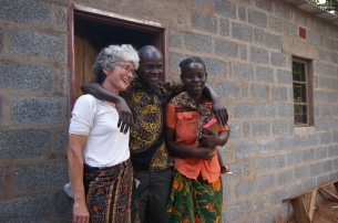 Yvonne, Michek and Helen outside her new home