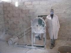 Corn Meal Mill worker