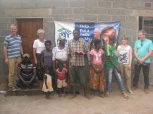 Elizabeth's family and team outside the finished house