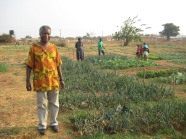 Pastor Francis and his garden that is used to feed the children attending the school