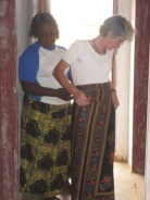Yvonne trying out the traditional skirt, Chetenge