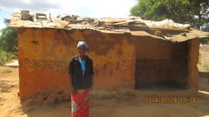 Moira Moloshi outside her old house